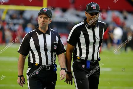 Stock Photo of Field judge Aaron Santi, left, and field judge Aaron Santi prior to an NFL football game between the San Francisco 49ers and the Arizona Cardinals, in Glendale, Ariz