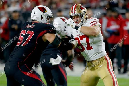 San Francisco 49ers defensive end Nick Bosa (97) battles against Arizona Cardinals offensive guard Justin Pugh (67) during the first half of an NFL football game, in Glendale, Ariz