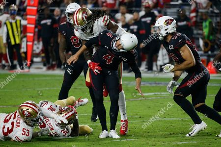 San Francisco 49ers defensive back Marcell Harris hits Arizona Cardinals punter Andy Lee (4) for a penalty during the second half of an NFL football game, in Glendale, Ariz