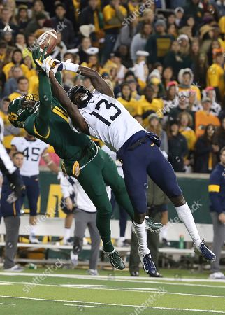 Baylor cornerback Jameson Houston (11) breaks up the pass intended for West Virginia wide receiver Sam James (13) during the second half of an NCAA college football game in Waco, Texas, . Baylor won 17=14