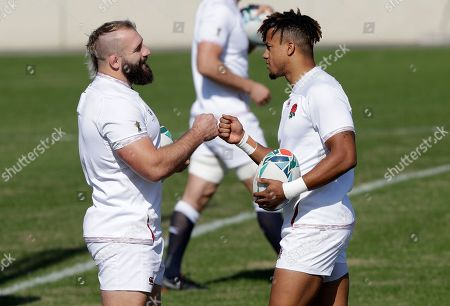 England's Joe Marler, left, and teammate Anthony Watson react during their final training session in Tokyo, Japan, Friday, Nov.1, 2019. England will play South Africa in the Rugby World Cup final on Saturday Nov. 2. in Yokohama