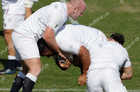 England's Dan Cole, left, tackles teammate England's Mako Vunipola with Tom Curry, right, during their final training session in Tokyo, Japan, Friday, Nov.1, 2019. England will play South Africa in the Rugby World Cup final on Saturday Nov. 2. in Yokohama