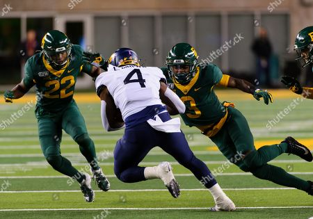 Stock Photo of Baylor Bears safety JT Woods (22) and Baylor Bears safety Chris Miller (3) tackle West Virginia Mountaineers running back Leddie Brown (4) during the 1st half of the NCAA Football game between West Virginia Mountaineers and the Baylor Bears at McLane Stadium in Waco, Texas
