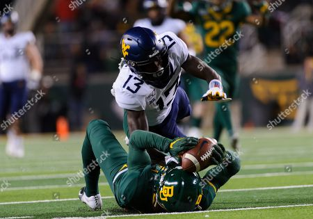 Baylor Bears cornerback Jameson Houston (11) breaks up a pass for West Virginia Mountaineers wide receiver Sam James (13) during the 2nd half of the NCAA Football game between West Virginia Mountaineers and the Baylor Bears at McLane Stadium in Waco, Texas