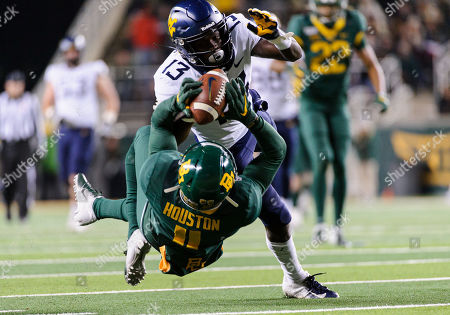 Stock Image of Baylor Bears cornerback Jameson Houston (11) breaks up a pass for West Virginia Mountaineers wide receiver Sam James (13) during the 2nd half of the NCAA Football game between West Virginia Mountaineers and the Baylor Bears at McLane Stadium in Waco, Texas