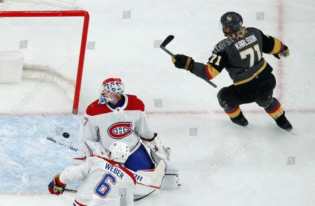 Vegas Golden Knights center William Karlsson (71) starts to celebrate after scoring on Montreal Canadiens goaltender Keith Kinkaid (37) during the first period of an NHL hockey game, in Las Vegas