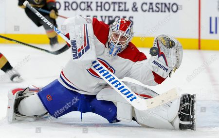 Montreal Canadiens goaltender Keith Kinkaid (37) makes glove save against the Vegas Golden Knights during the second period of an NHL hockey game, in Las Vegas