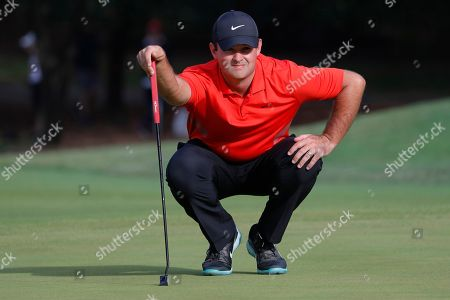 Francesco Molinari of Italy reads a green prior to putting during the second round of the HSBC World Golf Championships at the Sheshan International Golf Club in Shanghai, China, 01 November 2019.