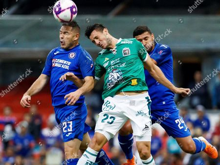 Stock Picture of Cruz Azul's Pablo Aguilar (L) and Juan Escobar (R) fight for the ball against Ramiro Gonzalez (C) of Leon during a Mexican Soccer Tournament match at Azteca Stadium in Mexico City, Mexico, 31 October 2019.