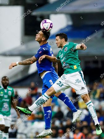 Cruz Azul's Milton Caraglio (L) vies for the ball against Ramiro Gonzalez (R) of Leon during a Mexican Soccer Tournament match at Azteca Stadium in Mexico City, Mexico, 31 October 2019.