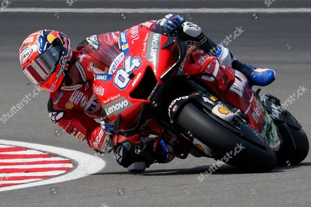 Italy's rider Andrea Dovizioso of the Ducati Team steers his bike during first practice at Sepang International Circuit ahead of the MotoGP Malaysian Grand Prix in Kuala Lumpur