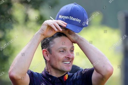 Justin Rose of England prepares to tee off for the HSBC Champions golf tournament at the Sheshan International Golf Club in Shanghai on