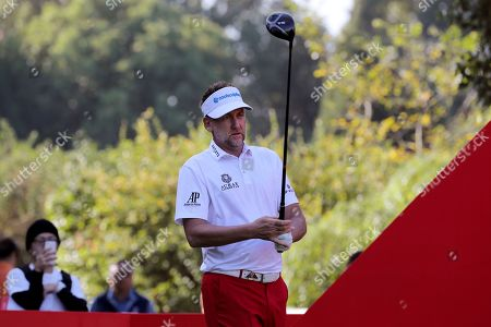Ian Poulter of England lines up his shot during the HSBC Champions golf tournament at the Sheshan International Golf Club in Shanghai on