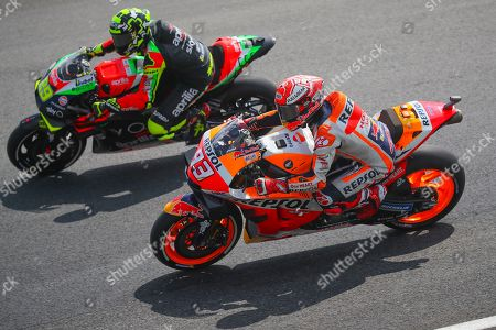 Stock Photo of Spanish MotoGP rider Marc Marquez (R) of Repsol Honda Team and Italian rider Andrea Iannone (L) of Aprilia Racing Team Gresini in action during the free practice of the Motorcycle Grand Prix of Malaysia 2019 at Sepang International Circuit, Selangor, Malaysia, 01 November 2019. The 2019 Malaysia Motorcycling Grand Prix will take place on 03 November 2019.