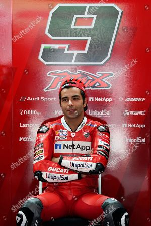 Stock Picture of Italy's rider Danilo Petrucci of the Ducati Team sits at his team garage during the second practice at Sepang International Circuit, ahead of the MotoGP Malaysian Grand Prix in Sepang