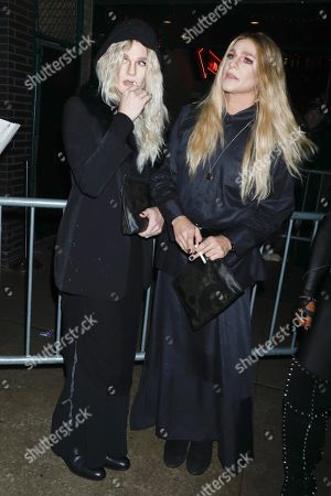 Stock Photo of Neil Patrick Harris and David Burtka, dressed respectively as Mary-Kate Olsen and Ashley Olsen