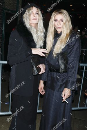 Stock Picture of Neil Patrick Harris and David Burtka, dressed respectively as Mary-Kate Olsen and Ashley Olsen