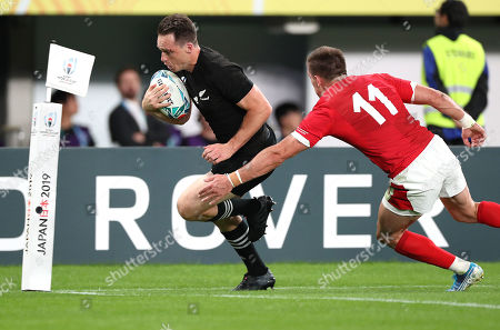 New Zealand vs Wales. New Zealand's Ben Smith scores their fourth try despite Josh Adams of Wales