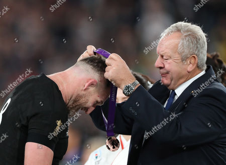 New Zealand vs Wales. Chairman of World Rugby, Bill Beaumont presents Kieran Read with his bronze medal