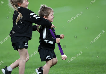 New Zealand vs Wales. Annabelle and Walter Smith, children of New Zealand's Ben Smith, with his bronze medal