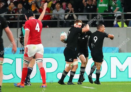New Zealand vs Wales. New Zealand's Ben Smith celebrates scoring their fourth try with Sam Cane and Aaron Smith