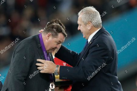New Zealand coach Steve Hansen, left, receives the bronze medal by World Rugby Chairman Bill Beaumont after the Rugby World Cup bronze final game at Tokyo Stadium between New Zealand and Wales in Tokyo, Japan