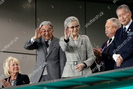 Japan's former emperor Akihito and Empress Michiko waves during the Rugby World Cup bronze final game at Tokyo Stadium between New Zealand and Wales in Tokyo, Japan