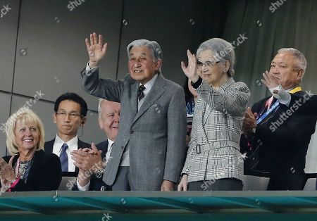 Former Emperor of Japan Akihito (C-L) and former Empress Michiko (C-R) wave at the crowd as they attend the Rugby World Cup Bronze Final match between New Zealand and Wales at the Tokyo Stadium, Tokyo, Japan, 01 November 2019.