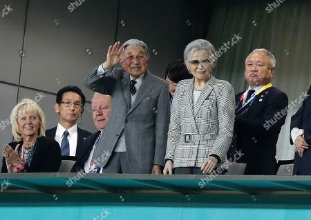 Former Emperor of Japan Akihito (C-L) and former Empress Michiko (C-R) attend the Rugby World Cup Bronze Final match between New Zealand and Wales at the Tokyo Stadium, Tokyo, Japan, 01 November 2019.