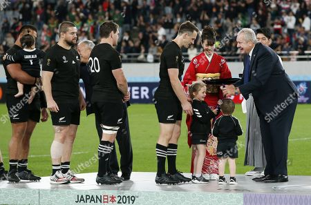 The children of New Zealand's Ben Smith (C) receive his Bronze medal after the Rugby World Cup Bronze Final match between New Zealand and Wales at the Tokyo Stadium, Tokyo, Japan, 01 November 2019.