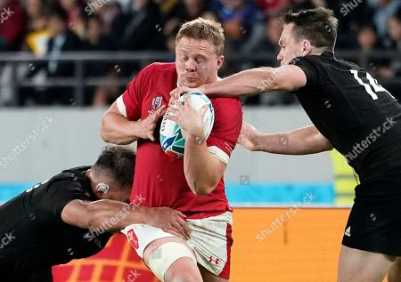 Ben Smith (R) and Angus Ta'avao (L) of New Zealand in action against James Davies (C) of Wales during the Rugby World Cup Bronze Final match between New Zealand and Wales at the Tokyo Stadium, Tokyo, Japan, 01 November 2019.