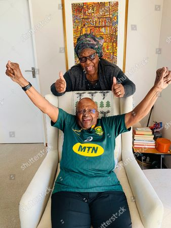 Anglican Archbishop Emeritus, Desmond Tutu and his wife Leah pose for a photo in Cape Town, South Africa, in support of the South African Springboks Rugby team. South Africa faces England Saturday, Nov. 2, 2019, in the final of the Rugby World Cup match being played in Japan