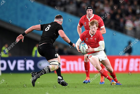 Rhys Patchell of Wales is challenged by Kieran Read of New Zealand.