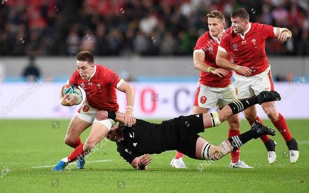 Josh Adams of Wales is tackled by Kieran Read of New Zealand.