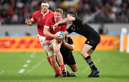 James Davies of Wales is tackled by Angus TaÕavao and Ben Smith of New Zealand.