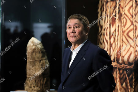 """Stock Picture of Takeshi Kitano speaks in front of a mummy, discovered in Peru as he is a special supporter of an exhibition """"Mummies of the World"""" at a press preview at the National Science Museum in Tokyo"""