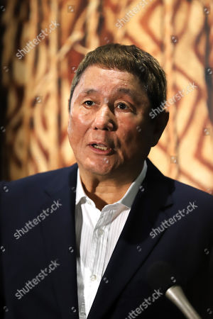 """Takeshi Kitano speaks in front of a mummy, discovered in Peru as he is a special supporter of an exhibition """"Mummies of the World"""" at a press preview at the National Science Museum in Tokyo"""