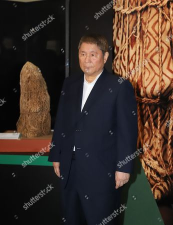 """Stock Image of Takeshi Kitano speaks in front of a mummy, discovered in Peru as he is a special supporter of an exhibition """"Mummies of the World"""" at a press preview at the National Science Museum in Tokyo"""