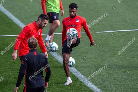Atletico Madrid's French midfielder Thomas Lemar (R) and midfielder Koke Resurreccion (L) attend a training session in Madrid, Spain, 01 November 2019. Atletico Madrid will play Sevilla FC in their LaLiga soccer match on 02 November 2019.