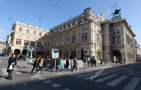 People walk past the Austrian State Opera in Vienna, Austria, where Placido Domingo will perform 'Macbeth' an opera by Italian composer Giuseppe Verdi on Friday