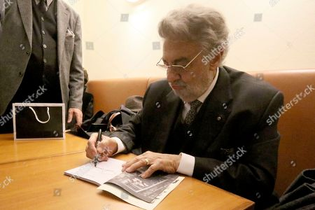 Stock Photo of Opera tenor Placido Domingo autographs after he performed 'Macbeth' from Giuseppe Verdi at Austrian State Opera in Vienna, Austria