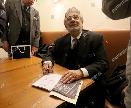 Opera tenor Placido Domingo autographs after he performed 'Macbeth' from Giuseppe Verdi at Austrian State Opera in Vienna, Austria