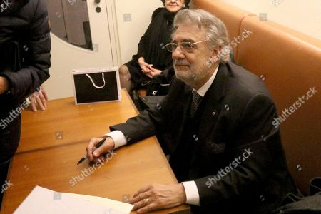 Opera tenor Placido Domingo waits to give autographs after he performed 'Macbeth' from Giuseppe Verdi at Austrian State Opera in Vienna, Austria