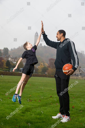 Stock Image of Kieron Achara with from Wallace High School pupil Henry Crossley