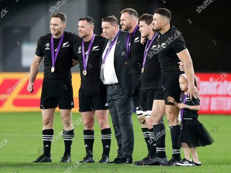 Retiring All Black players and coach from left, Ben Smith, Ryan Grotty, coach Steve Hansen, Kieran Read, Matt Todd and Sonny Bill Williams pose for a photo after the Rugby World Cup bronze final game at Tokyo Stadium between New Zealand and Wales in Tokyo, Japan