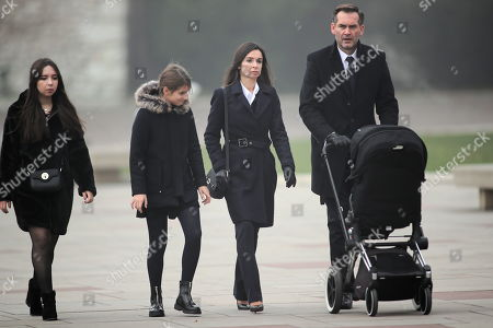Marta Kaczynska (2-R), daughter of a former presidential couple, with her husband Piotr Zielinski (R) and daughters Ewa (L) and Martyna (2-L), on his way to the crypt under the Tower of Silver Bells in Wawel, in Krakow, Poland, 01 November 2019. The crypt contains the sarcophagus of the presidential couple, Lech and Maria Kaczynski.