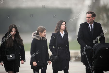 Stock Picture of Marta Kaczynska (2-R), daughter of a former presidential couple, with her husband Piotr Zielinski (R) and daughters Ewa (L) and Martyna (2-L), on his way to the crypt under the Tower of Silver Bells in Wawel, in Krakow, Poland, 01 November 2019. The crypt contains the sarcophagus of the presidential couple, Lech and Maria Kaczynski.