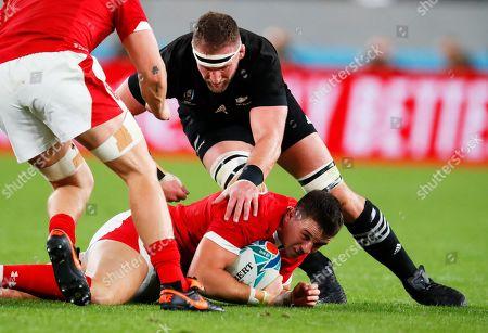 Kieran Read of New Zealand and Owen Watkin of Wales