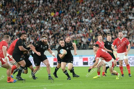 Ben Smith of New Zealand runs for scoring his first try during the 2019 Rugby World Cup Bronze Final match between New Zealand and Wales at the Tokyo Stadium in Tokyo, Japan.