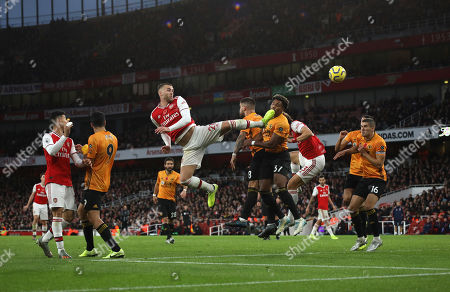 Calum Chambers (A) heads an effort towards goal at the Arsenal v Wolverhampton Wanderers English Premier League game at The Emirates Stadium, UK on November 2, 2019. **Editorial use only, license required for commercial use. No use in betting, games or a single club/league/player publications**